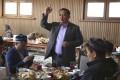 Activist Serikjan Bilash speaks to a crowd of Kazakhs at a restaurant in Almaty, Kazakhstan in March 2018. Photo: AP