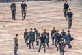 Members of the People's Armed Police Force stage an anti-riot drill in Shenzhen. Photo: EPA-EFE