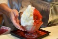 Shop owner Koji Morinishi makes a kakigori dessert with natural ice in the Yanaka district of Tokyo. Photo: AFP