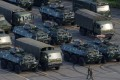 Military vehicles parked on the grounds of the Shenzhen Bay Sports Centre in Shenzhen. Photo: Reuters