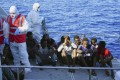 Migrants are evacuated from the Open Arms Spanish humanitarian boat. Photo: AP Photo
