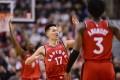 Toronto Raptors guard Jeremy Lin (No 17) celebrates a basket against the Washington Wizards. Photo: AP