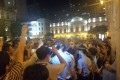 Police officers and protesters gather at Senado Square, in Macau. Photo: Facebook