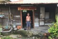 An elderly villager outside his wooden house in Kampung Cempaka, Malaysia. Photo: Project Community Kampung Cempaka