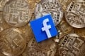 A 3-D printed Facebook logo is seen on representations of the Bitcoin virtual currency in this illustration picture, June 18, 2019. Photo: Reuters