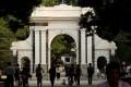 People walk near the gate of Tsinghua University in Beijing. Photo: Reuters