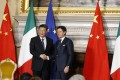 Ties with China have warmed while Giuseppe Conte (right) has been Italy's prime minister. Photo: EPA-EFE