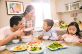 Sitting around a table for a family dinner can create a healthy and happy environment, but you may need to know a few handy tips first. Photo: Alamy