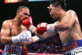 Manny Pacquiao slams a right hand to the face of Keith Thurman. Photo: AFP