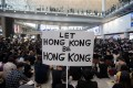 A poster spells out the mood as protesters rally in the arrivals hall of Hong Kong International Airport on August 9. The demonstrations were part of a three-day sit-in to call for the withdrawal of a suspended extradition bill and the introduction of universal suffrage, as well as to raise awareness among international visitors about alleged police brutality against protesters. Photo: EPA-EFE
