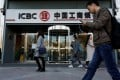 People walk past a branch of the Industrial and Commercial Bank of China in Beijing on April 1, 2019. Photo: Reuters