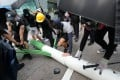 Anti-government protestors disassemble a smart lamp post near the Zero Carbon Building, Kowloon Bay on Saturday. Photo: Dickson Lee