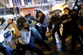 Police and protesters clash during a night of violence in Tsuen Wan, Hong Kong on Sunday night. Photo: Reuters