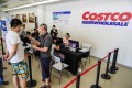 Shanghai residents sign up for membership of the country's first Costco outlet. Photo: AFP