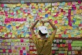 "A man reads messages posted on a ""Lennon Wall"" in Tsuen Wan in July. Hong Kong Chief Executive Carrie Lam and the protesters can start with their common ground: their love for Hong Kong. Photo: Sam Tsang"
