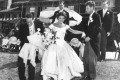 Jackie Kennedy in the wedding gown designed by Ann Lowe on September 12, 1953. Groom John F. Kennedy is second from right. Photo: Toni Frisell / John F. Kennedy Presidential Library and Museum