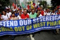Filipino activists protest outside the Chinese embassy in April. Photo: Reuters