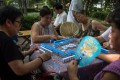 A game of mahjong being played in public in Beijing, China. Photo: EPA-EFE