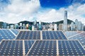 A view of Hong Kong's skyline from across solar panels. The city can play a role in using green finance to fight climate change. Photo: Shutterstock