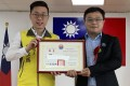 Lee Meng-chu (right) receives a certificate for his work with the Fangliao township in Taiwan from mayor Chen Ya-lin in June. Photo: AP