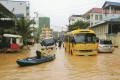 Submerged cars, buses and motorbikes were abandoned throughout the city during heavy flooding in Sihanoukville, Cambodia, early last month. Photo: Mother Nature