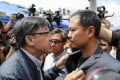 Pro-Beijing lawmaker Junius Ho Kwan-yiu (left) argues with pro-democracy lawmaker Dennis Kwok Wing-hang before a demonstration of a water cannon-equipped vehicle at the compound of the Police Tactical Unit in Fanling on August 12. Photo: Sam Tsang