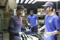 This image released by Netflix shows Wong He, left, working with Kenny Taylor, centre, and Jarred Gibson, right, in the furnace tempering area of the Fuyao Glass America Factory in Dayton, Ohio, in the documentary film, American Factory. Photo: Netflix via Associated Press