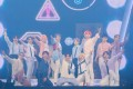 The 13-member K-pop boy band SEVENTEEN salute the crowd during Sunday's Seoul concert, before leaving South Korea for concerts abroad as part of its second world tour, Ode To You.