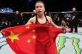 Zhang Weili celebrates after becoming China's first UFC champion. Photo: Brandon Magnus/Zuffa LLC