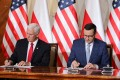 Polish Prime Minister Mateusz Morawiecki and US Vice-President Mike Pence during the signing of the declaration. Photo: EPA-EFE
