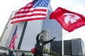 A protester waves the American and Hong Kong flags during a march on July 21. Photo: Edmond So