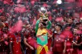 Liverpool's Adrian lifts the trophy as he celebrates winning the Uefa Super Cup with teammates. Photo: Reuters
