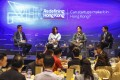 South China Morning Post Technology editor Chua Kong Ho Post (left) moderates a panel with Norma Chu of DayDayCook (second from left), Yat Siu of Animoca Brands and Outblaze, and legislator Charles Mok at the latest edition of the Post's Redefining Hong Kong series held on Thursday at the JW Marriott Hotel in Admiralty. Photo: K Y Cheng