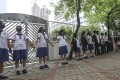 Students from six secondary schools form a human chain along Siu Sai Wan Road on September 2, the first day of the new school term when tens of thousands of university and secondary students boycotted class and joined anti-government rallies. Photo: Nora Tam