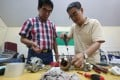Volunteers Siu Wing-kai (left), 70 years old, and 60-year-old Lee King at the Repair Cafe in Tai Po. Photo: David Wong