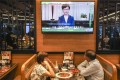 Diners listen as TV stations play a pre-recorded message from Chief Executive Carrie Lam announcing the withdrawal of the extradition bill, on September 4. Photo: Robert Ng