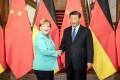 German Chancellor Angela Merkel shakes hands with Chinese President Xi Jinping in Beijing. Photo: EPA-EFE