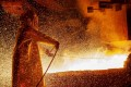 A worker mans a furnace on March 30, 2019, during the nickel smelting process at Indonesian mining company PT Vale's smelting plant in Soroako, South Sulawesi. Photo: Agence France-Presse
