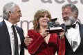 French actress Emmanuelle Seigner accepts the Venice Film Festival's Grand Jury Prize for Roman Polanski's movie An Officer and a Spy with the film's producers Luca Barbareschi (right) and Alain Goldman. The prize represented a defeat for the #MeToo movement. Photo: EPA-EFE