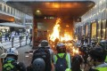 Protesters start a fire at an entrance of Central MTR Station on September 8. Photo: Edmond So