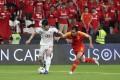 Iran's Sardar Azmoun dribbles past China's Feng Xiaoting in the 2019 AFC Asian Cup quarter-final. Photo: Xinhua