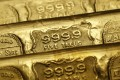 Five-tael (6.65 ounces or 190 grams) gold bars are seen at a jewellery store in Hong Kong. Gold prices have risen in recent months. Photo: Reuters