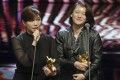Taiwanese director Fu Yue (left) delivers her acceptance speech next to producer Hong Ting-yi after winning the best documentary prize at the 2018 Golden Horse Awards. In her speech she said she wanted the world to recognise the island as an independent country. Photo: AP