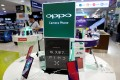 Oppo smartphones are displayed in a shop in Singapore August 8, 2018. Photo: Reuters
