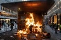 A fire set by protesters blazes at an entrance to Central station on September 8. Photo: Bloomberg