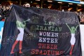 """Fans hold a banner reading """"Let Iranian women enter their stadiums"""" during the friendly international football match between Sweden and Iran at the Friends Arena in Solna near Stockholm in March 2015. File photo: AFP"""