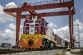A Kenya Railways goods train pulls shipping containers as it departs from the port station on the Mombasa-Nairobi Standard Gauge Railway line in Mombasa, Kenya. The prime contractor was the China Road and Bridge Corporation, which hired 25,000 Kenyans to work on the railway. Photo: Bloomberg