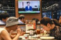 Hongkongers continue to eat as Chief Executive Carrie Lam speaks during a pre-recorded message televised on September 4, as she announced the withdrawal of the extradition bill and an independent study to probe social ills. Photo: Robert Ng