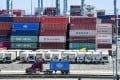 Container trucks arrive at the Port of Long Beach in California. Equities have become more attractive for Credit Suisse amid a slight easing of tensions in the trade standoff. Photo: AFP