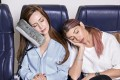 The JetComfy travel pillow attaches to the armrest and provides a fixed cushion for the head.